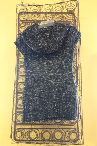This cowl-necked top features monochromatic colour-dipped yarn Photo: Urban Thrift